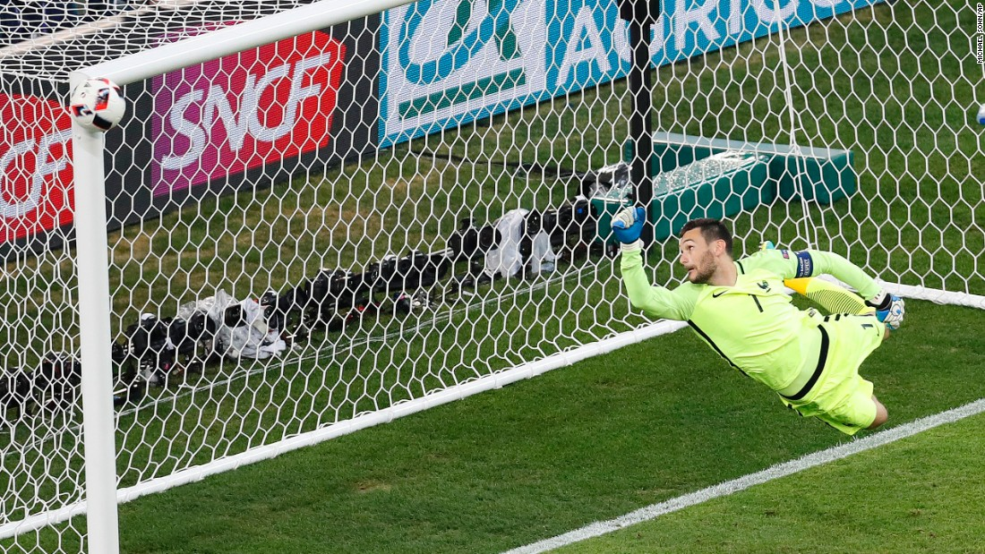 France goalkeeper Hugo Lloris watches as a shot from Germany's Joshua Kimmich hits the post during the Euro 2016 semifinal soccer match on Thursday, July 7. The French won 2-0 to advance to the final against Portugal.