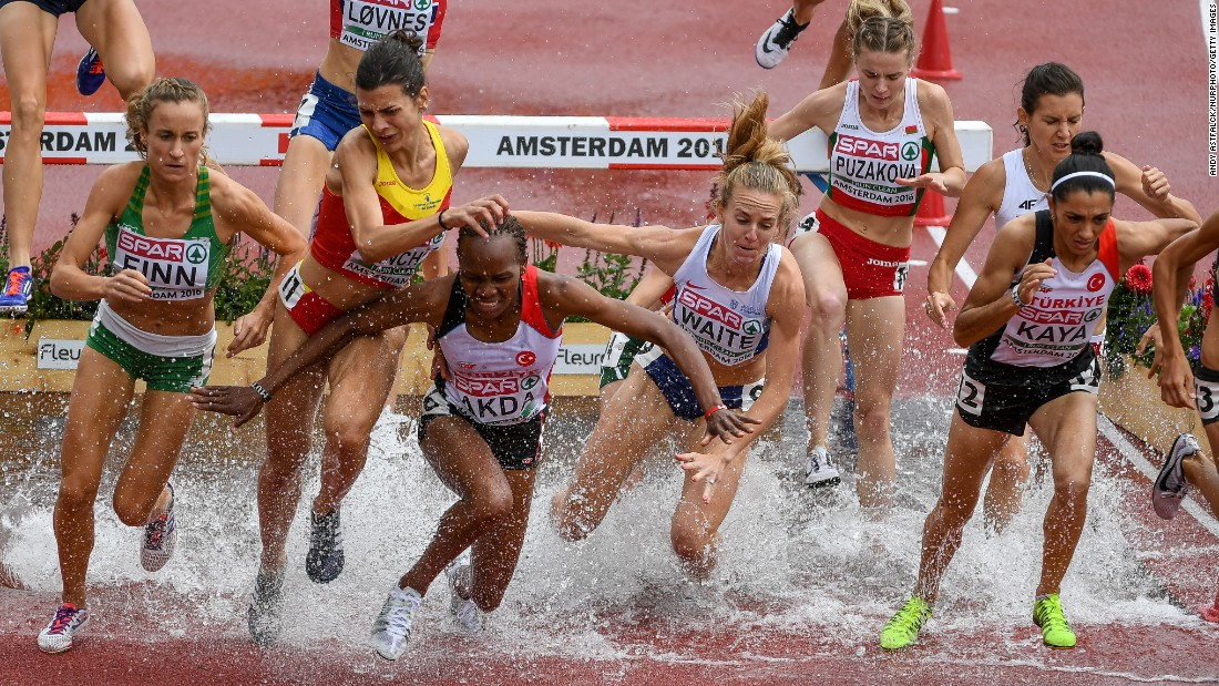 Turkey's Meryem Akda, third from left, stumbles in the water pit during the first lap of the women 3,000-meter steeplechase at the 23rd European Athletics Championships on Friday, July 8.