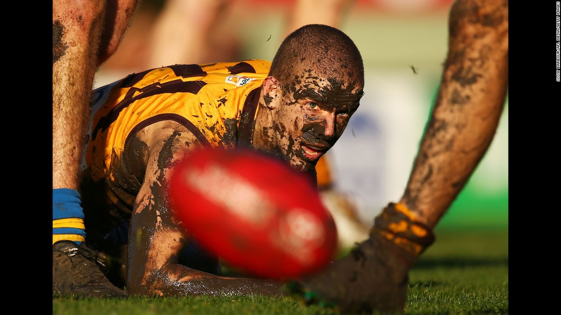 Sam Switkowski of Box Hill competes for the ball covered in mud during the round 14 Victorian Football League match against Williamstown in Melbourne, Australia, on Saturday, July 9.