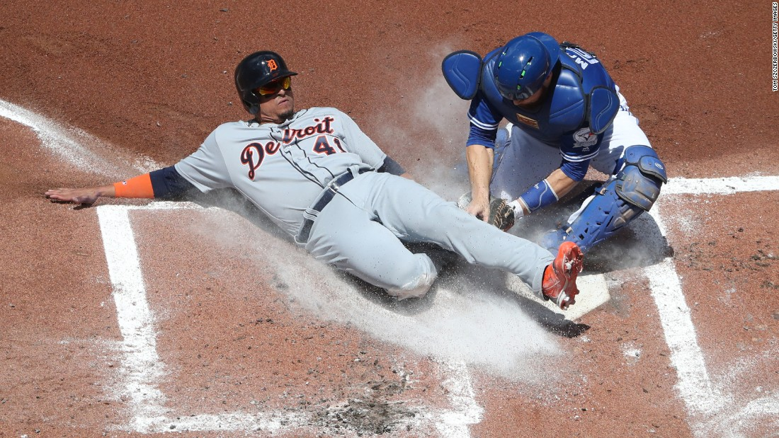 Russell Martin of the Toronto Blue Jays tags out Victor Martinez of the Detroit Tigers in a game in Toronto on Saturday, July 9.