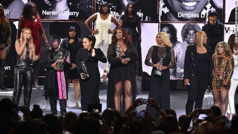 Host Eve with honorees Missy Elliott, members of Salt-N-Pepa, Queen Latifah, and Lil' Kim on Monday.