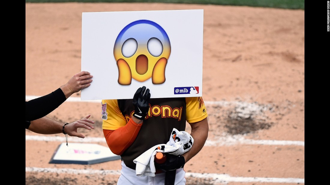Miami Marlins player Giancarlo Stanton holds an emoji during the Home Run Derby on July 11. Stanton hit a total of 61 homers for the night.
