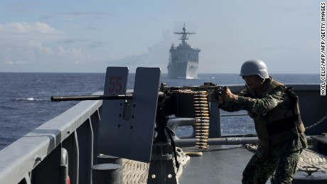 A Philippine Navy personnel mans a .50 caliber machine gun during the bilateral maritime exercise between the Philippine Navy and US Navy dubbed as Cooperation Afloat Readiness and Training (CARAT 2014) in the South China Sea near waters claimed by Beijing on June 29, 2014.  The United States and the Philippines conducted joint naval exercises in the South China Sea near waters claimed by Beijing, amid tense territorial rows between China and its neighbours. AFP PHOTO/POOL/NOEL CELIS        (Photo credit should read NOEL CELIS/AFP/Getty Images)