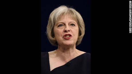 Britain's Home Secretary Theresa May addresses delegates on the third day of the annual Conservative party conference in Manchester, north west England, on October 6, 2015. AFP PHOTO / LEON NEAL        (Photo credit should read LEON NEAL/AFP/Getty Images)