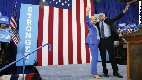 Democratic presidential candidate Hillary Clinton and Sen. Bernie Sanders, I-Vt. wave during a rally in Portsmouth, N.H., Tuesday, July 12, 2016, where Sanders endorsed Clinton for president.