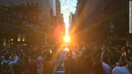"""The """"Manhattanhenge"""" sunset was perfectly aligned Monday, giving onlookers a visual treat in New York."""