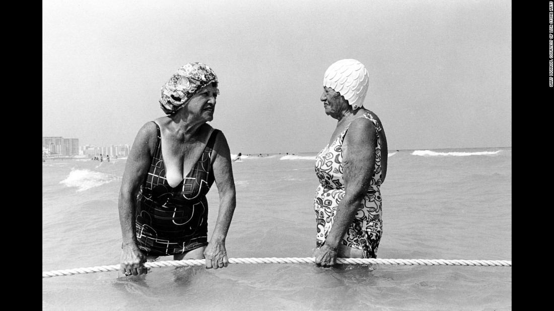 """Women hold a rope at the 10th Street beach in Florida in 1980. Leica camera in hand, <a href=""""http://www.garymonroe.net/"""" target=""""_blank"""">Gary Monroe</a> spent about a decade photographing life in South Beach. """"The camera was seen very differently then,"""" he said. """"Everything was open to me, and I was welcomed to photograph."""""""