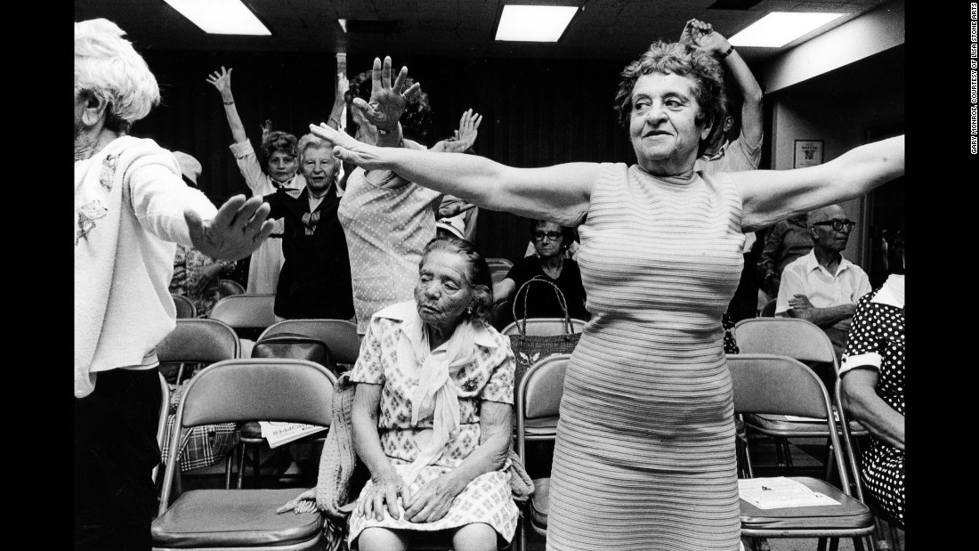"""An exercise group in a bank building on Washington Avenue in 1980. The South Beach neighborhood has undergone a trendy transformation and become one of the world's premier art deco districts. """"If the age of people who go to South Beach now is between 18 and 28, it was about 81 or 82 then,"""" the photographer said. """"I was an insider and an outsider 30 years ago; now I see it as it was and as it is, and the two views don't quite jive. Now, it's as if the South Beach that others and I knew and loved never existed."""""""