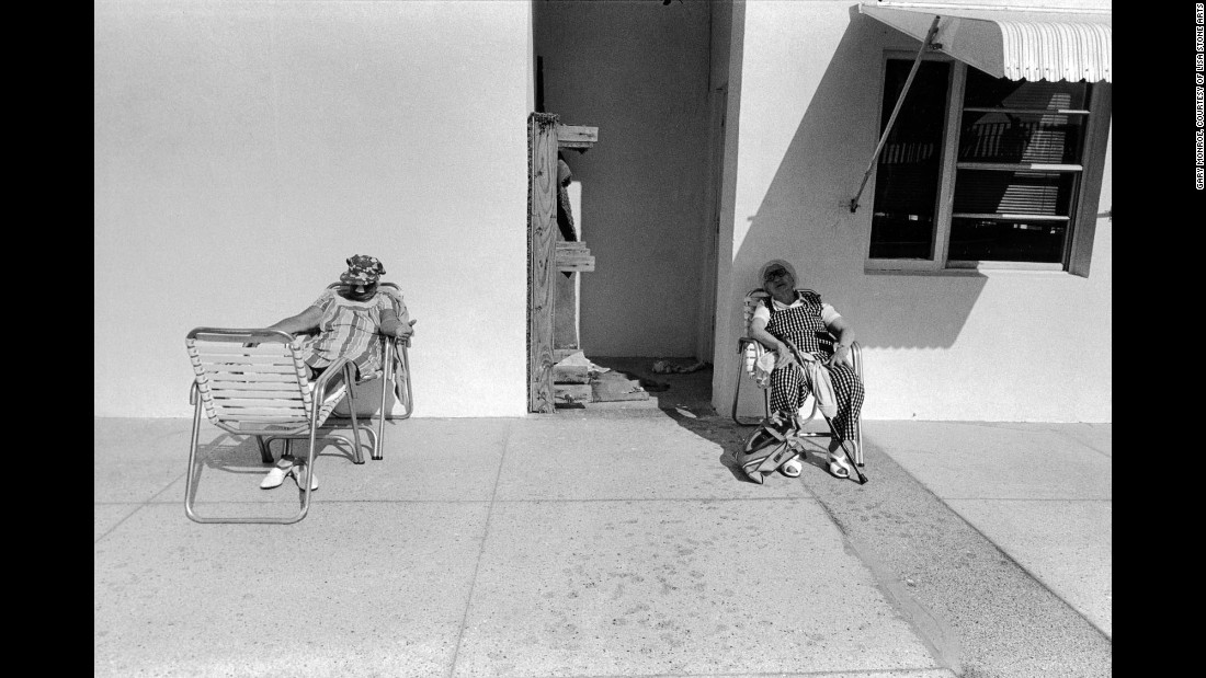 """Women sit poolside along Ocean Drive in 1979. Even after all these years, Monroe says friends, family and photography often take him back to South Beach. """"Suffice to say that I found the old South Beach way more interesting than it is today -- in every way,"""" Monroe said. """"I was photographing there a couple weeks ago and noticed that the scores of outdoor cafes obscure the art deco architecture of the hotels lining Ocean Drive."""""""