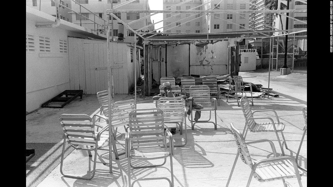 """A man is surrounded by chairs in 1982. Monroe describes the South Beach of now as a place comprised of """"clubbing 'til dawn, drinking from supersized fishbowl glasses and finding a parking space."""""""