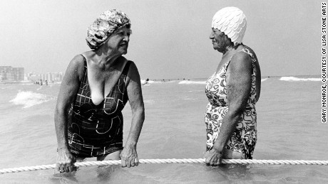 Women holding rope at 10th Street beach, 1980