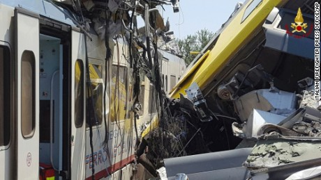 The collision of two trains leave wagon cars crumpled at the scene Tuesday.