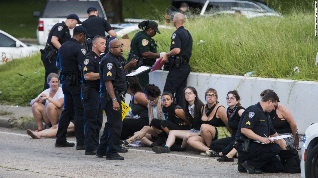 Protesters sit after being arrested after a march on July 10 in Baton Rouge, Louisiana. Many cities have seen an increase in protests since police-involved shootings.