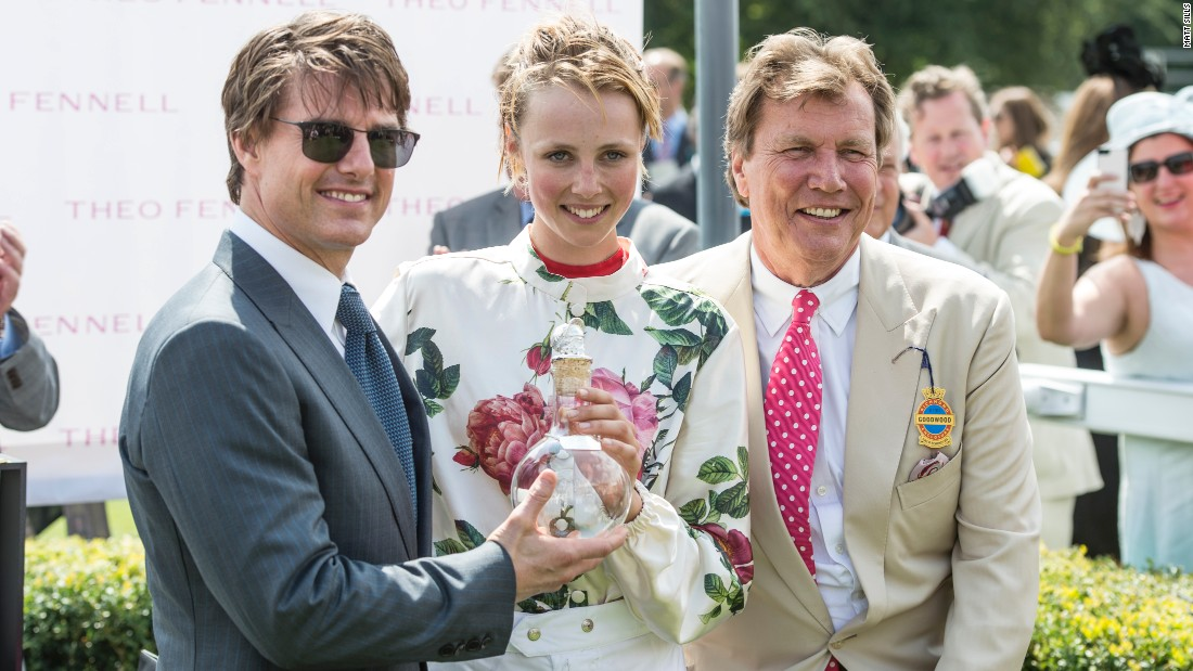 British model Edie Campbell receives the winner's trophy from film star Tom Cruise in 2014.