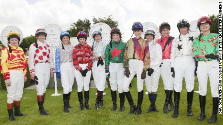 Dido Harding, Philippa Holland, Gina Bryce, Alysen Miller, Harriet Bond, Francesca Cumani, Edie Campbell, Emma Spencer, Rosemary Ferguson, Tricia Simonon, Sara Cox before The Magnolia Cup on Ladies Day at Glorious Goodwood 2012, Goodwood Racecourse, Chichester.