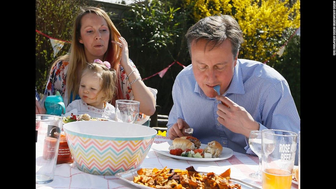 Cameron is captured on camera eating a hot dog with a knife and fork during the 2015 general election campaign.