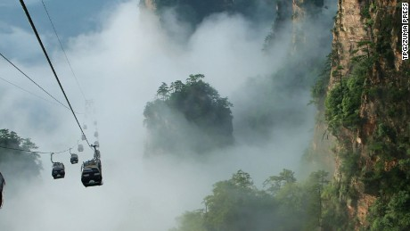July 7, 2016 - Zhangjiajie, Hunan, China - The cable cars of tourism go through the sea of clouds caused by a rain which just like fairyland at the Tianzi mountain in Zhangjiajie,Hunan,China on 7th July 2016. (Credit Image: © Tpg via ZUMA Press)