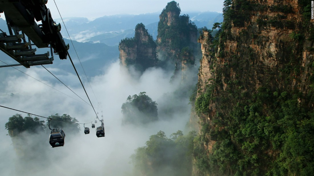 China's Tianmen Shan cable car is one of the longest cable-car rides in the world, covering a distance of 7,455 meters (24,459 feet) and ascending to 1,279 meters (4,196 feet). The car runs from Zhangjiajie railway station up to the top of Tianmen Shan, which translates as Heaven's Gate Mountain.