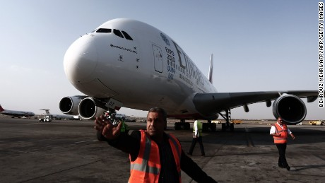 An Airbus A380-800 airctaft of Emirates Airline sits on the tarmac after landing at Tehran's IKA airport on September 30, 2014. Dubai's Emirates Airline made a one-off flight to the Iranian capital, for the first time with its flagship Airbus A380 plane to celebrate its recent introduction of more flights on the route. AFP PHOTO/BEHROUZ MEHRI        (Photo credit should read BEHROUZ MEHRI/AFP/Getty Images)