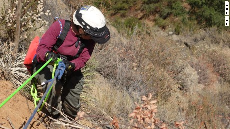 Gove, a San Diego County animal control officer, rappels into the ravine.