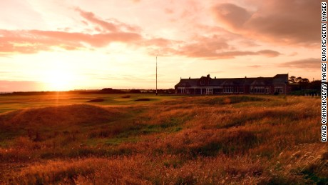 TROON, SCOTLAND - JULY 29:  A view of the Clubhouse and the green on the 457 yards par 4, 18th hole 'Craigend' at sunset on the Old Course at Royal Troon Golf Club the venue for the 2016 Open Championship on July 29, 2015 in Troon, Scotland.  (Photo by David Cannon/Getty Images)