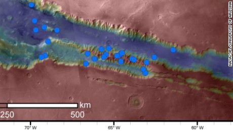 The blue dots indicate active sites of RSL in the Valles Marineris canyon region. These are the highest density of RSL known.