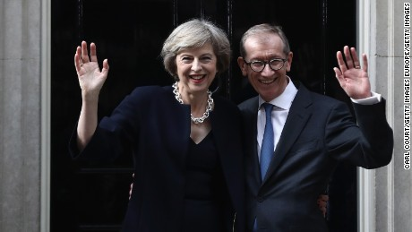 LONDON, ENGLAND - JULY 13:  British Prime Minister Theresa May and husband Philip May wave outside 10 Downing Street on July 13, 2016 in London, England. Former Home Secretary Theresa May becomes the UK's second female Prime Minister after she was selected unopposed by Conservative MPs to be their new party leader. She is currently MP for Maidenhead.  (Photo by Carl Court/Getty Images)