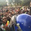 Zimbabwe protest crowds with phones