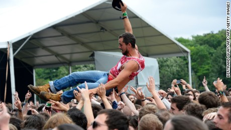 A participant is carried by people as they dance during the hard rock music Download festival in Paris on June 12, 2016. Download Festival gathers in the UK since 2003 fans of heavy guitars and powerful rock, but this year another edition is staged in Paris from June 10 to June 12, 2016. / AFP / BERTRAND GUAY        (Photo credit should read BERTRAND GUAY/AFP/Getty Images)