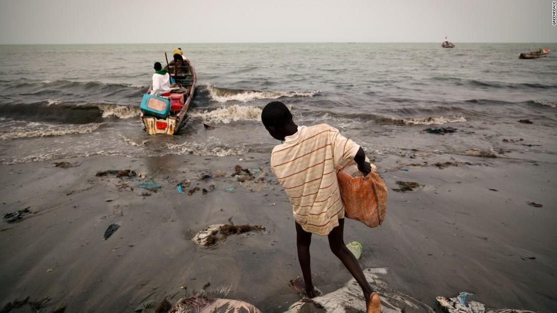 Fishermen preparing their boats at Joal beach in Senegal.