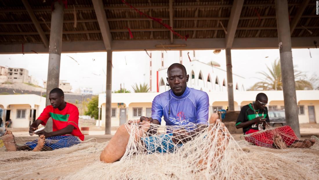 Fishermen check their nets in the fishing port of Ouakam, Dakar.