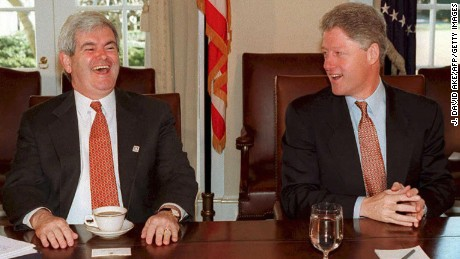 House Speaker Newt Gingrich laughing beside US President Bill Clinton during a meeting of the bi-partisan leadership of Congress at the White House in Washington, DC in 1995.