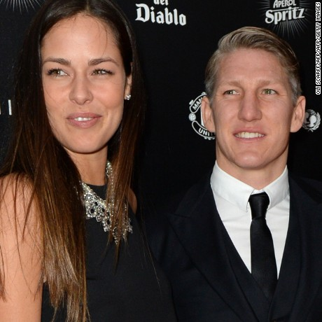 "Manchester United's German midfielder Bastian Schweinsteiger (R) and his partner, tennis player Ana Ivanovic pose for pictures on the red carpet as they arrive to attend the ""United for UNICEF Gala Dinner"" at Old Trafford in Manchester, north-west England, on November 29, 2015.   AFP PHOTO / OLI SCARFF / AFP / OLI SCARFF        (Photo credit should read OLI SCARFF/AFP/Getty Images)"