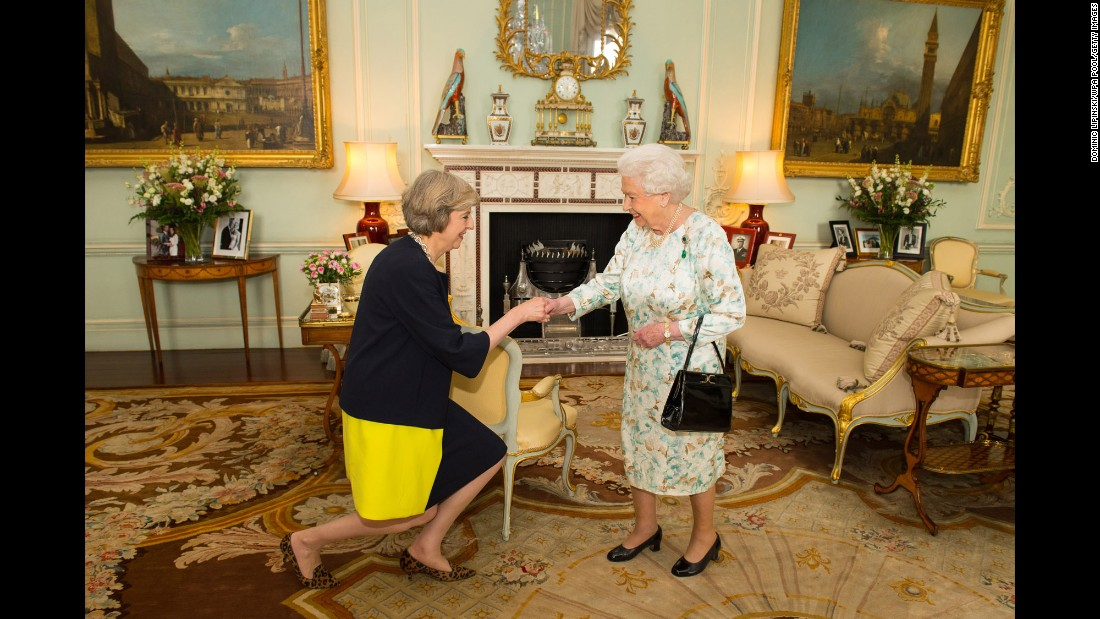 """Queen Elizabeth II welcomes Theresa May, after inviting the former Home Secretary to become Prime Minister and form a new government, at Buckingham Palace in London on Wednesday, July 13. David Cameron resigned from the position after his country's vote to leave the European Union, making May the <a href=""""http://www.cnn.com/2016/07/13/europe/theresa-may-david-cameron-british-prime-minister/"""" target=""""_blank"""">United Kingdom's second female Prime Minister</a>."""