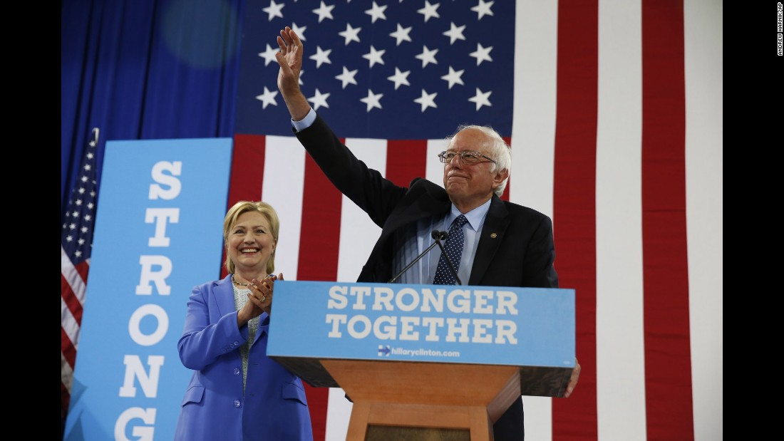 """Vermont Sen. Bernie Sanders waves as he and Democratic presidential candidate Hillary Clinton arrive for a rally in Portsmouth, New Hampshire, on Tuesday, July 12. After an unsuccessful campaign for the Democratic nomination, <a href=""""http://www.cnn.com/2016/07/11/politics/hillary-clinton-bernie-sanders/"""" target=""""_blank"""">Sanders officially endorsed Clinton</a>, saying, """"I intend to do everything I can to make certain she will be the next president of the United States."""""""