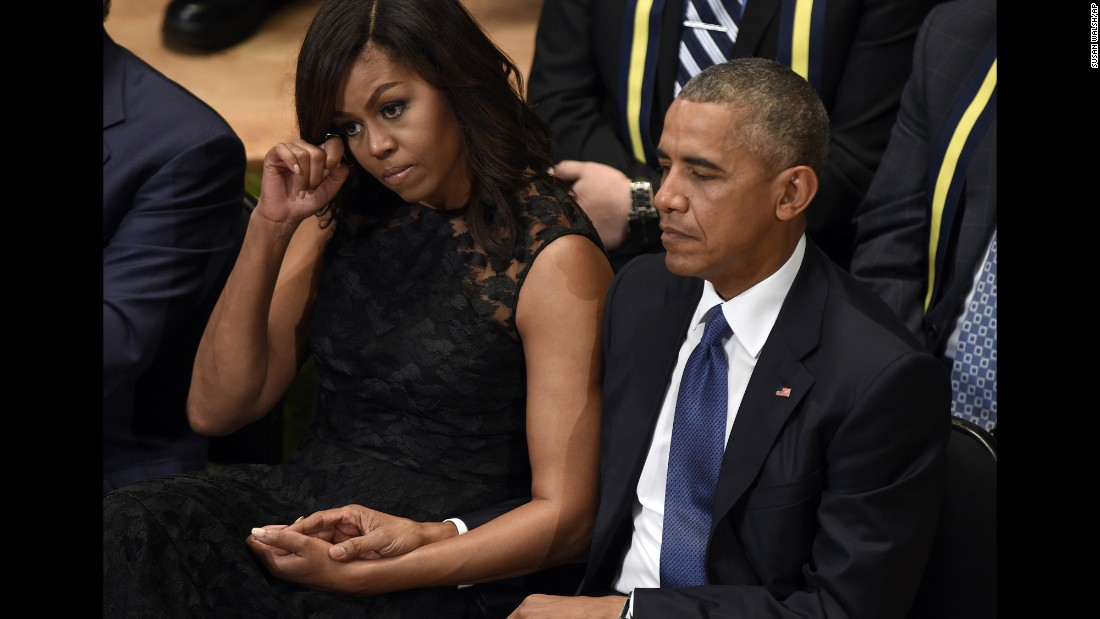 """U.S. President Barack Obama and first lady Michelle Obama attend an interfaith memorial service in Dallas on Tuesday, July 12, after the <a href=""""http://www.cnn.com/2016/07/08/us/philando-castile-alton-sterling-protests/index.html"""" target=""""_blank"""">killing of five police officers</a> during an anti-police brutality protest in the city just days before."""