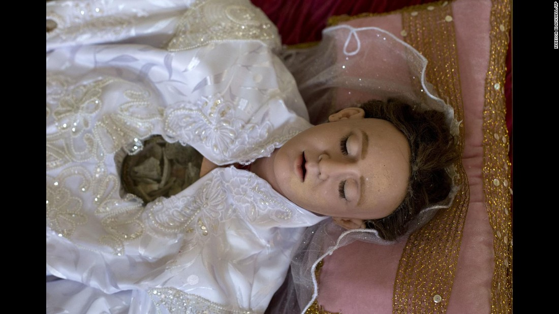 A molded wax and cloth figure of Saint Felicitas of Rome lies inside a display case at the Metropolitan Cathedral in Mexico City on Friday, July 8. High definition digital x-ray technology is giving researchers their first glimpse at the interiors of centuries-old life-size religious reliquaries representing Catholic saints. The figure has a glass window embedded in the chest to reveal bone fragments.