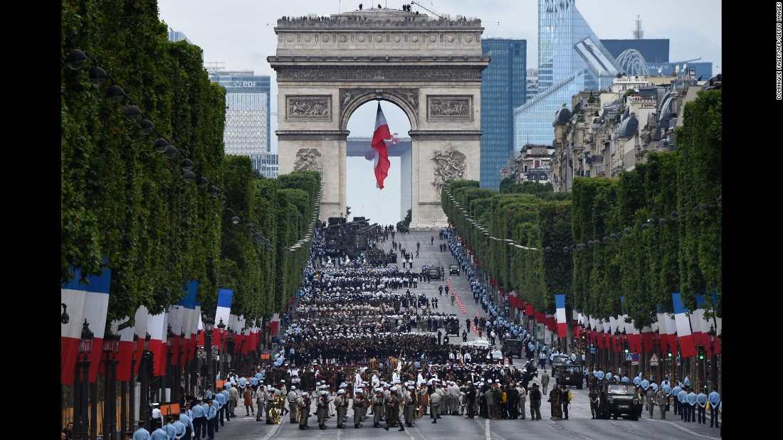 """Troops wait near the Arc de Triomphe in Paris before taking part in the annual <a href=""""http://www.cnn.com/videos/world/2016/07/14/france-bastille-day-anderson-cnni-nr-lklv.cnn/video/playlists/top-news-videos/"""" target=""""_blank"""">Bastille Day parade</a> on the Champs-Elysees on Thursday, July 14. About 3,000 soldiers marched at the event, which marks the beginning of the French Revolution in 1979."""
