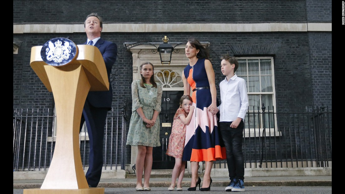 """Former British Prime Minister David Cameron speaks to the media as his wife and children look on at 10 Downing Street in London on Wednesday, July 13. Tuesday marked <a href=""""http://www.cnn.com/2016/07/12/europe/david-cameron-downing-street-removal/"""" target=""""_blank"""">the final full day of Cameron's six-year run as Prime Minister</a>."""