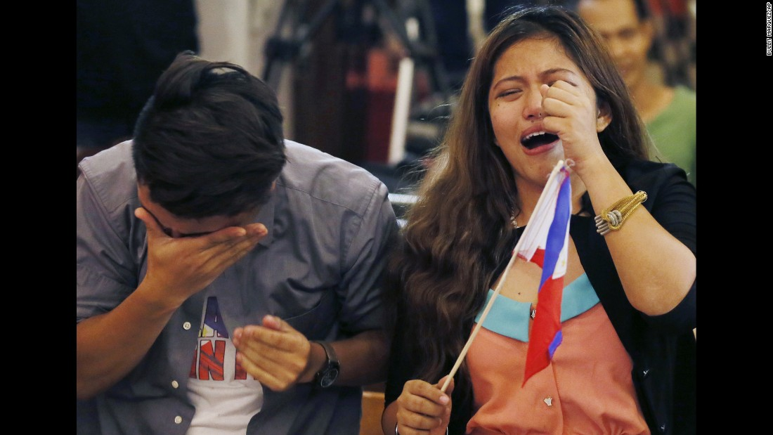 """People in Manila, Philippines, react after an international tribunal in <a href=""""http://www.cnn.com/2016/07/12/asia/china-philippines-south-china-sea/"""" target=""""_blank"""">The Hague ruled in favor of the Philippines</a> in a maritime dispute with China on Tuesday, July 12. The Hague concluded China has no legal basis to claim historic rights to the bulk of the South China Sea."""