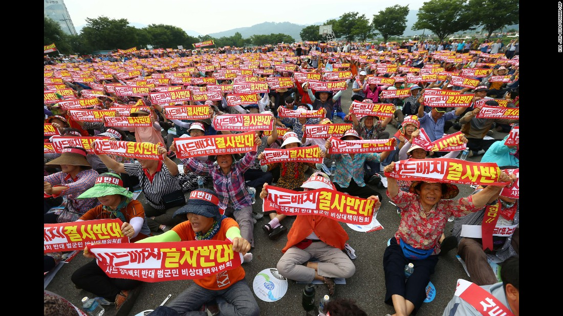 """People hold up banners during a rally to oppose deploying the Terminal High-Altitude Area Defense, or THAAD, in Seongju, South Korea, on Wednesday, July 13. <a href=""""http://www.cnn.com/2016/07/13/asia/what-is-thaad/"""" target=""""_blank"""">An advanced U.S. missile defense system will be deployed</a> in a rural farming town in southeastern South Korea, Seoul officials announced Wednesday, angering not only North Korea and China but also local residents who fear potential health hazards they believe the U.S. system might cause. The banners state, """"Oppose deploying the THAAD."""""""