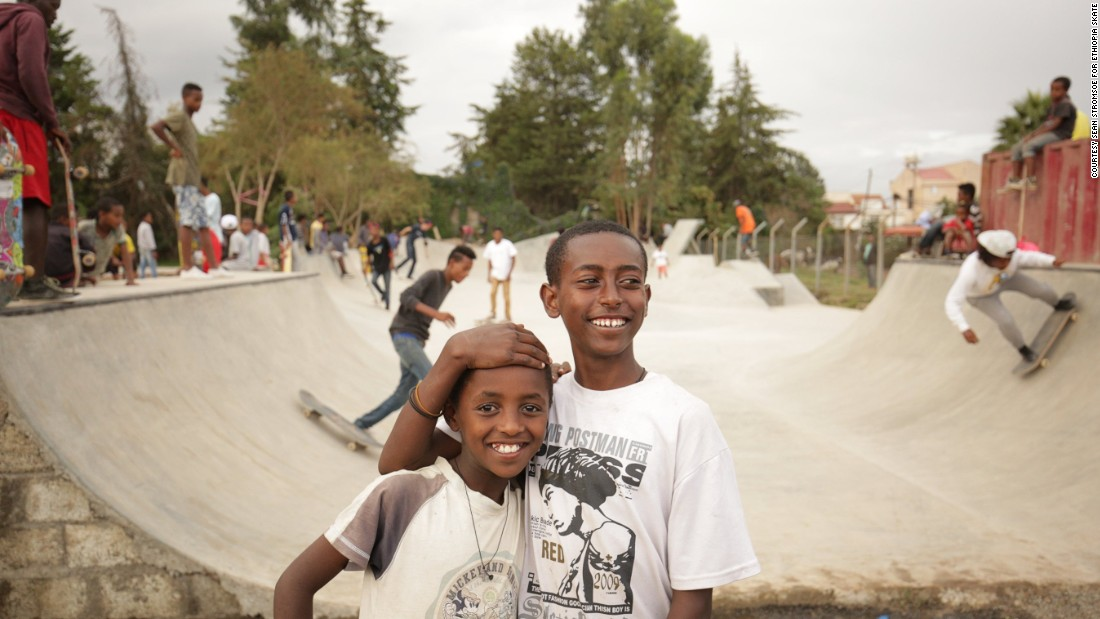 Young skaters hang out outside the new Addis skate park. The local community in Addis Ababa learned from and worked alongside a team of over 60 volunteers from over 20 countries to build the park.