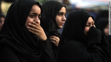 Iraqi women react as people gather on July 9, 2016 at the site of a suicide-bombing attack which took place on July 3 in Baghdad's Karrada neighbourhood.  The Baghdad bombing claimed by the Islamic State group killed 292 people, according to a new toll issued on July 7, many of whom were trapped in blazing buildings and burned alive. A suicide bomber detonated an explosives-laden minibus early on July 3, ahead of the Eid al-Fitr holiday marking the end of the holy Muslim fasting month of Ramadan. / AFP / AHMAD AL-RUBAYE        (Photo credit should read AHMAD AL-RUBAYE/AFP/Getty Images)