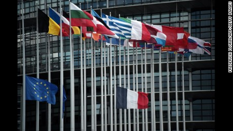 The French and European Union flags fly at half-mast in front of the European Parliament building in Strasbourg, France, on Friday, July 15.
