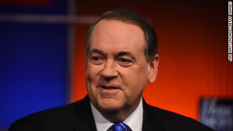 Then-Republican presidential candidate Mike Huckabee looks on during the undercard Republican Presidential debate sponsored by Fox News at the Iowa Events Center in Des Moines, Iowa on January 28.
