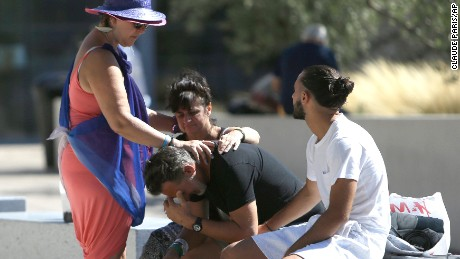 Relatives of the victims of the Bastille Day attack comfort each other as they gather in front of Pasteur Hospital in Nice, southern France on Friday, July 15, 2016.