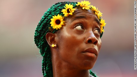 Flower power:  Fraser-Pryce ahead of winning 100m gold at the 2015 world championships.
