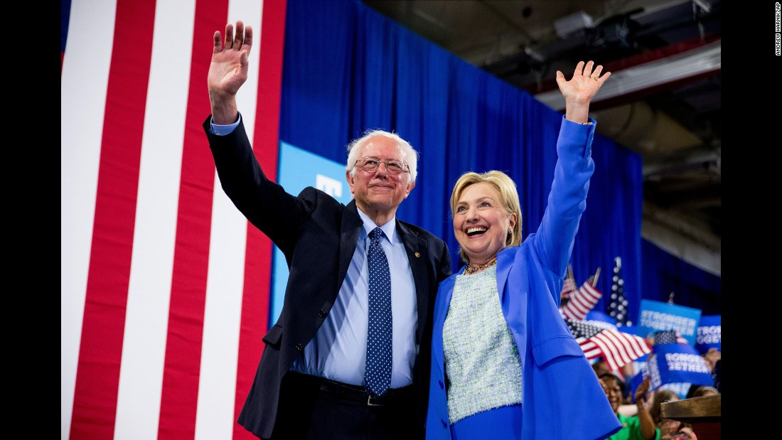 """Vermont Sen. Bernie Sanders and Democratic presidential candidate Hillary Clinton wave to supporters during a rally in Portsmouth, New Hampshire, on Tuesday, July 12. <a href=""""http://www.cnn.com/2016/07/11/politics/hillary-clinton-bernie-sanders/"""" target=""""_blank"""">Sanders officially endorsed Clinton</a>, saying, """"I intend to do everything I can to make certain she will be the next president of the United States."""""""