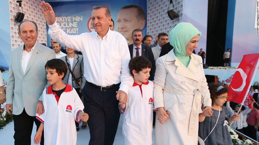 Erdogan, his wife Emine, his grandchildren and Istanbul Metropolitan Municipality Mayor Kadir Topbas, left, greet the crowd at a presidential election rally in Istanbul on August 3, 2014.