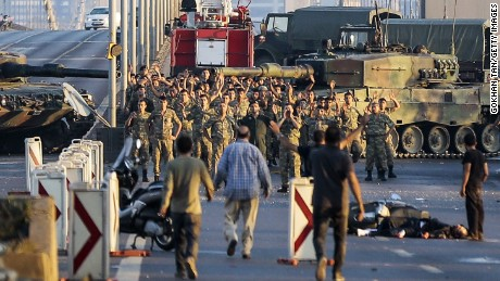 Soldiers in the coup attempt surrender Saturday on Istanbul's Bosphorus Bridge.